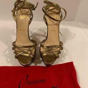 Christian Louboutin gold foiled platform heel pump